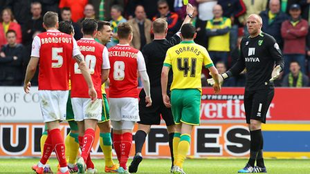 John Ruddy sprints from his goal to confront referee Mark Brown and gets a yellow card for his troub