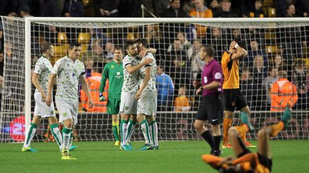 In total contrast to the match at Newcastle, the Norwich City players celebrate victory as the Wolve