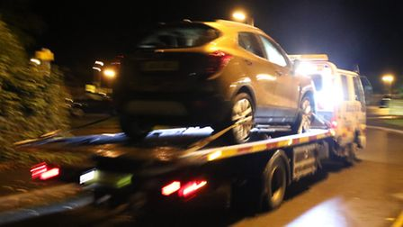 A recovery vehicle removes the car from the scene of fatal smash in Holt. Picture: ALLY McGILVRAY