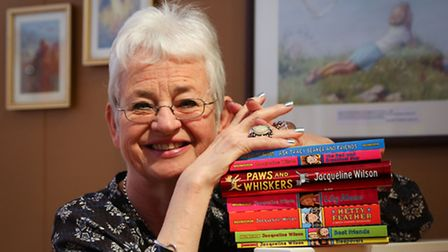 Dame Jacqueline Wilson poses for photographers in a recreation of her childhood bedroom during a pho