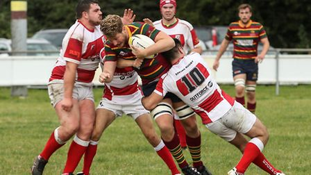 Norwich man-of-the-match Tom Lloyd in the thick of the action against Epping Upper Clapton at Beesto
