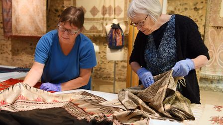 The Norwich Shawls exhibition at the Hostry. Beth Walsh, left, and Jan Miller, of the Costume and Te