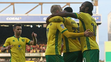Steven Naismith is congratulated after sealing Norwich City's win. Picture by Paul Chesterton/Focus