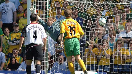 Robert Green sees the second of Fulham's six goals fired past him during Norwich City's Craven Cotta