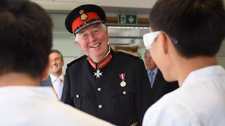 The Lord Lieutenant, Richard Jewson, speaks to chemistry students making nylon in the labs at INTO U