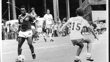 Norwich's Steve Buttle shadows the great Pele playing for Seattle Sounders against the Brazilians Ne