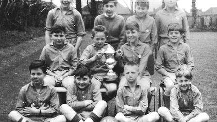 The young Buttle holds aloft a trophy for the all-conquering South Harford side of 1963/64.