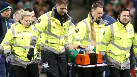 Republic of Ireland's Robbie Brady waves to the home crowd as he is stretchered off during his count