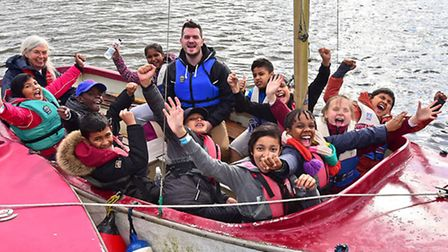 Children from St Paul with St Luke School in Mile End, London at Barton Turf Adventure Centre. Enjoy