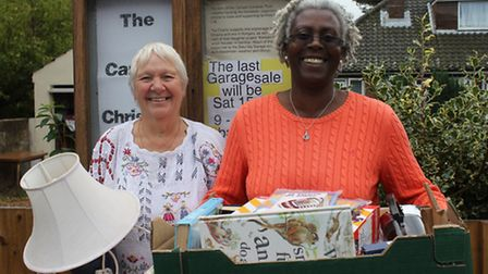 Canaan Christian Centre founder Evelyn Smith and caretaker Winsome Grant with some of the household