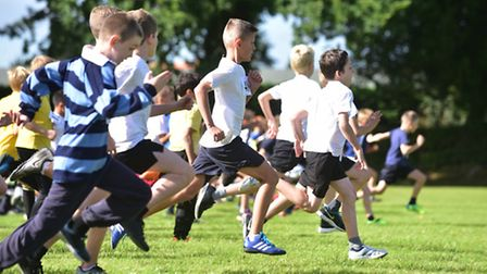 Youngsters from schools across Norfolk compete in a cross country race at Greshams school.PHOTO: Ni