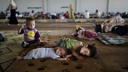 Syrian children who fled due to fighting between the Syrian army and the rebels. Pic: AP Photo/Muham