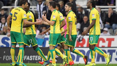 The Norwich City players celebrate Graham Dorrans' equaliser at Newcastle. Picture: Paul Chesterton/