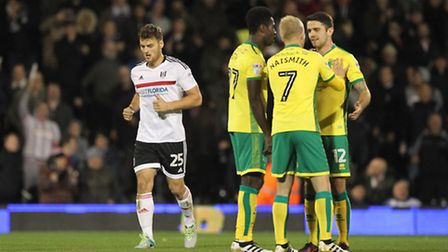 The Norwich City players look dejected after conceding their second goal at Fulham. Picture: Paul Ch