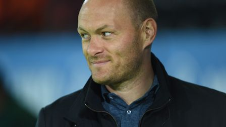 Norwich City first team manager Alex Neil was an interested spectator at Barnet on Tuesday night. Pi