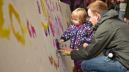 Magdalen Street Celebration. Dave Sheehy and his daughter Erin, 2, painting a canvas.Picture: ANTONY