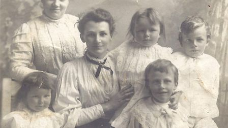 Phyllis Dennis, of Beeston Regis, is the eldest daughter pictured on her mother's lap. Picture: SHER