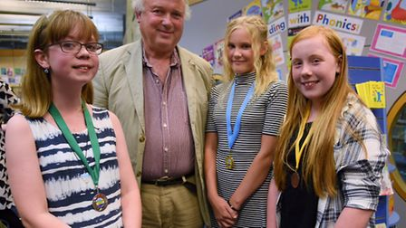 Three of the winners of the Write On Norfolk competition, with judge, author, Louis de Bernieres. Fr