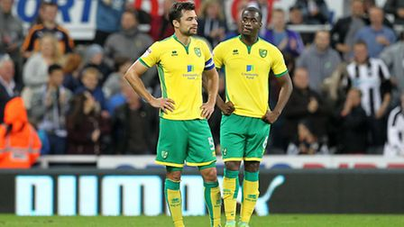 Norwich City duo Russell Martin and Sebastien Bassong had a tough night against Newcastle United's s