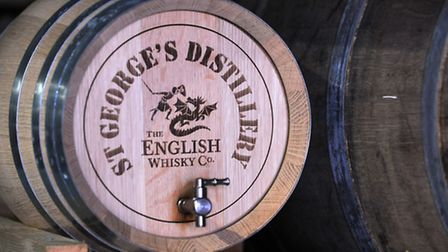 Barrells of whiskey are stored at The English Whiskey Company in Roudham. Photograph Simon Parker
