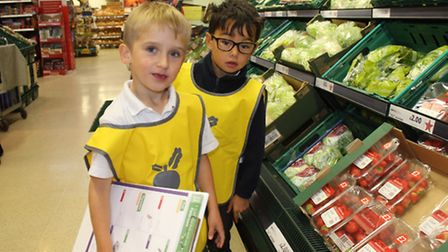 Pals Henry and Oliver spot different coloured fruit and veg in in the aisles at Tesco, Sheringham. P