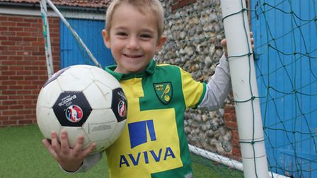 """Four-year-old Riley, who dreams of playing for Norwich City and """"tackling everybody"""". Picture: KAREN"""