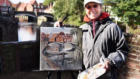 Artist Anthea Eames at work painting Fye Bridge during the Norwich Paint Out. Picture: DENISE BRADLE