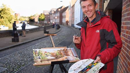 Artist Robert Nelnes at work painting Whitefriars Bridge during the Norwich Paint Out. Picture: DENI