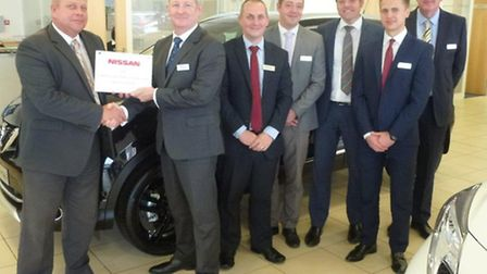 Paul Marshall, of Nissan Motors GB, left, presents a Nissan Customer Quality Retailer of the Year aw