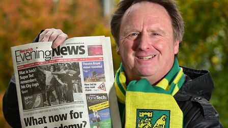 Paul Freeman pictured with the front of today's Norwich Evening News which has an old photo of him w