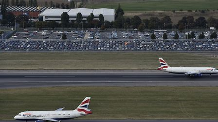 British Airways planes taking off and landing at London's Heathrow Airport. The Economy and Industri