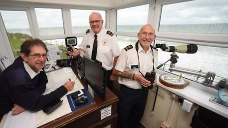 Bob White, right, Mundesley Coastwatch station manager, keeping an eye on the sea and beaches with c