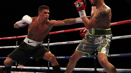 Anthony Ogogo (left) and Craig Cunningham during the vacant WBC International Middleweight Champions