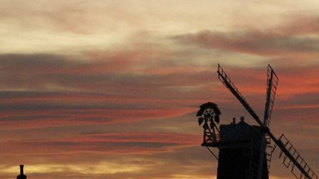Sunset behind Cley windmill by @the_old_bakery