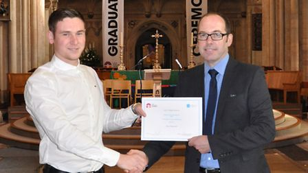 Civil engineer Alex Fitzgerald, from Watton, receives the HND Civil Engineering Award for Excellence