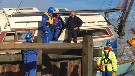 The yacht's owner (right with dark jacket) talks to coastguards on the stricken yacht at Cart Gap, n