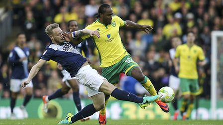 Tom Clarke of Preston North End (left) competing with Cameron Jerome of Norwich City (right) during