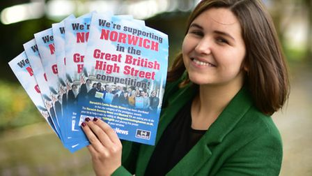 Reporter Hannah Lawrence with the Norwich in the Great British High Street competition posters.Pictu