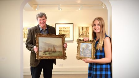 John Allen with an Alfred Stannard painting called Yarmouth Beach and Rachel Allen with a George Vin