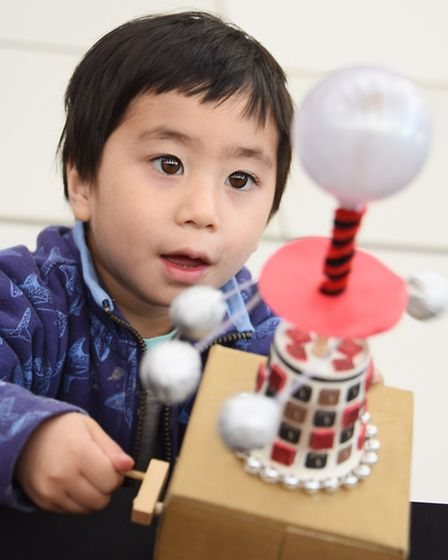 The Physics event at the Norwich Science Festival at the Forum. Vince Chung, three, with one of the