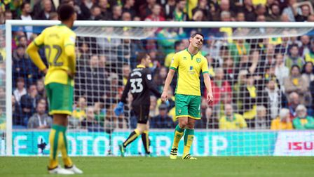 The Norwich players look dejected after Glenn Murray of Brighton & Hove Albion opens the scoring dur