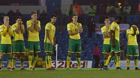 Captain for the night Ryan Bennett, centre, watches the shootout unfold at Leeds. Picture: Paul Ches
