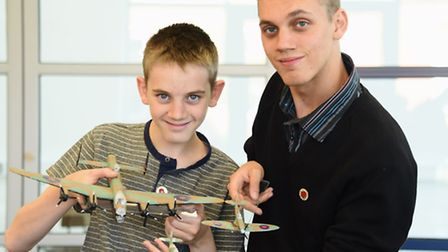 Alex, left, and Jamie Staddon, with their grandfather, Derrick Eagle's models of the three Battle of