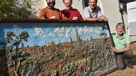 Members of the norwich Society complete the purchase of a Moray-Smith panorama of Norwich from Caist