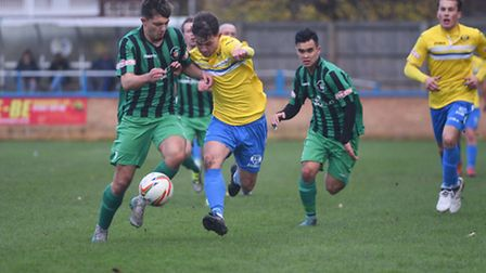 Action from King's Lynn Town's recent Southern Premier League clash against Cinderford Town.