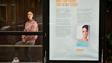 Acid attack victim Adele Bellis by the bus stop where she was attacked. Picture: NICK BUTCHER