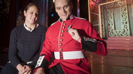 Costume designer Laura Whyte and dancer Kris Spencer with a First World War medal. Picture: NICK BUT