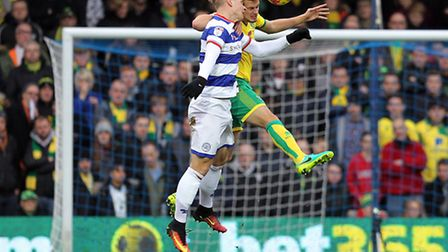 Sebastian Polter of Queens Park Rangers and Ryan Bennett of Norwich in action during the Sky Bet Cha