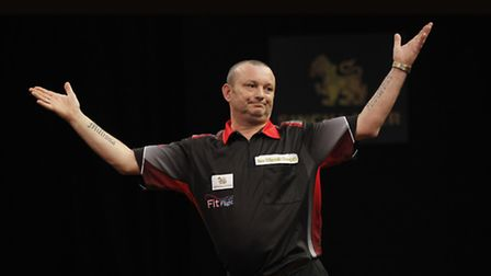 Darren Webster celebrates his 5-0 win over Phil Taylor at the Grand Slam of Darts. Picture: LAWRENCE
