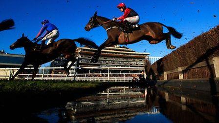 Roman Flight, (right) jumps the water jump on the way to winning The Bet365 Open Handicap Chase dur